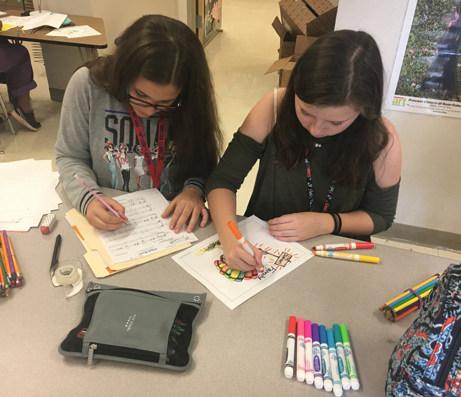 Some students express their creativity in Art Club.
