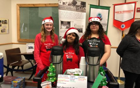 Students serve hot chocolate, baked goods and huge smiles at Central Office.