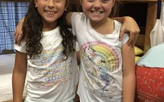 Students Laci Reifenberg and Graycee Porter grew up going to summer camp together.